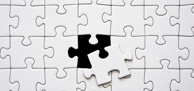 Imatge d'un puzzle amb una peça pendent d'encaixar